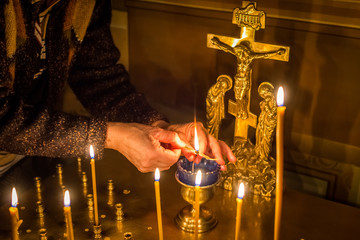 the hands of a Christian reaching for a candle, hands with candles,