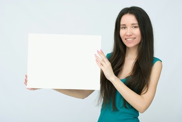 happy smiling woman with white blank board
