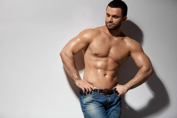 Handsome Smiling Young Man With Sexy Fit Muscular Body Indoors