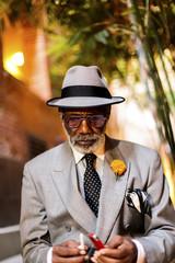 An African American gentleman enjoys a smoke.