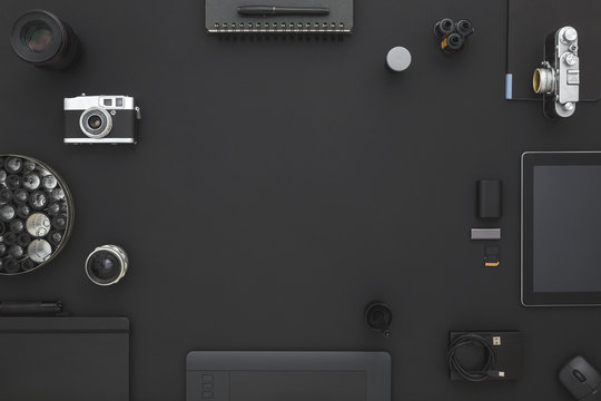 Black desk of photographer or designer.