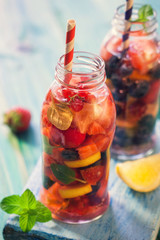 Infused water with fresh berry fruits,lemon, orange and Mint