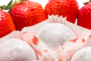Daifukumochi, a Japanese confection consisting of a small round mochi stuffed with sweet filling with fresh strawberries