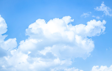 White cumulus clouds against blue sky