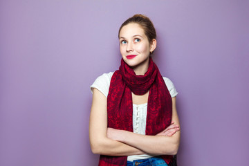 Thinking girl. Portrait closeup funny confused skeptical woman girl female thinking trying to recall looking upwards purple wall background. .Human expressions emotions feelings body language..
