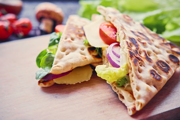 Pita bread with ham, cucumber and tomatoes.