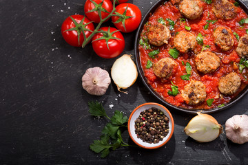 pan of meatballs with tomato sauce