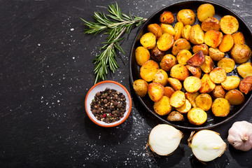 Photo Stands Ready meals pan of roasted potatoes with rosemary
