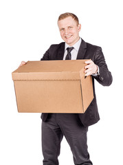 man holding a big box isolated on white background. Concept of difficult career of a businessman