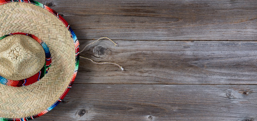 Traditional large sombrero for Cinco de Mayo holiday party celebration on rustic wooden boards