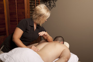 Massage therapist massaging client