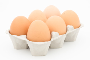 eggs in a box on white background