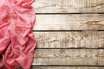 Red gauze fabric on brown wooden table