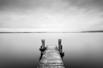 Frozen time.  Black and white. Minimalistic landscape on the lake. Long exposure.