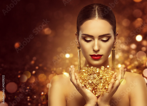 "Beautiful Girl Holding Fashion Beauty Magazine Stock Image: ""Fashion Model Holding Gold Jewelry In Hands, Woman Golden"