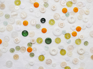 Background of multi-colored buttons. Abstract background. Pattern of buttons on a white background.
