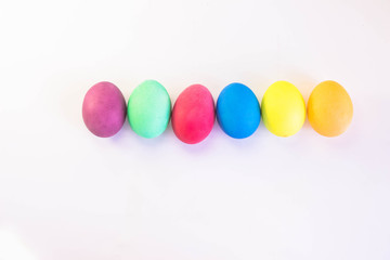 Row of colorful easter eggs isolated on a white background