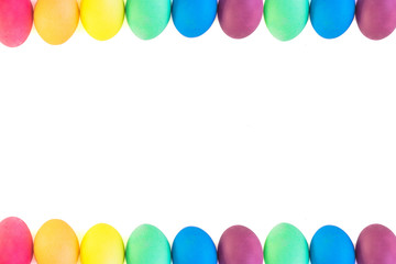 Rows of colorful easter eggs on a white background
