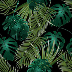 Jungle thickets of tropical palm leaves. Seamless floral pattern. Isolated on a black background. illustration
