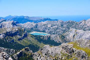 High mountains range with a blue lake on the island of Mallorca