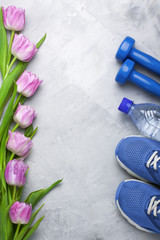 Spring flatlay composition with sport equipment and tulips