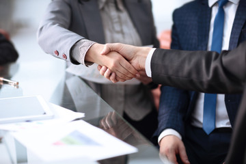 Close up view of business partnership handshake concept.Photo of two businessman handshaking process.Successful deal after great meeting