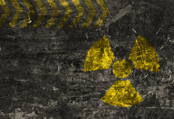 Old grunge distressed black metal plate with radiation warning