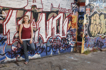 Young Teen Girl in Pigtails with Graffiti
