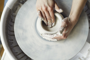 Ceramic working process with clay potter's wheel, close-up of woman hands Fototapete