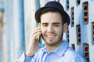 portrait of young man modern talking on mobile phone