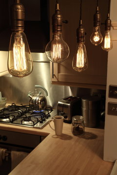 Making coffee with glowing filament Edison filament light bulbs