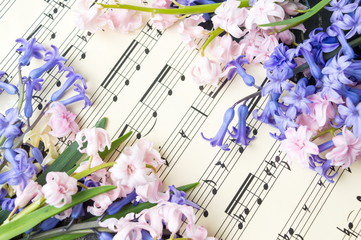 Music note sheet and hyacinth flowers