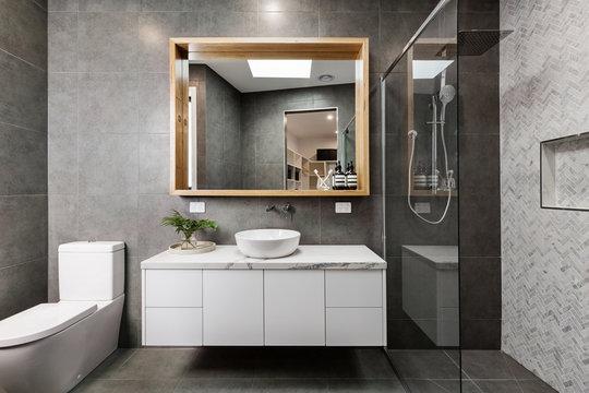 Modern designer bathroom with herringbone shower tiling