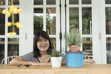 Asian teenage girl having fun at home naturally .