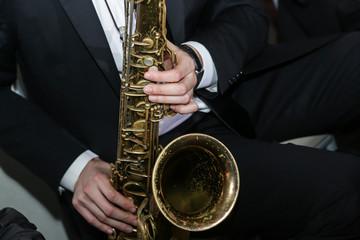A man playing a saxophone instrument musician
