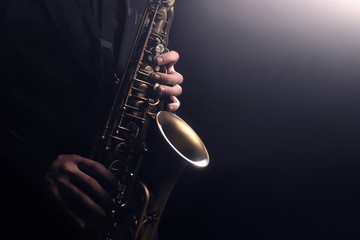 Photo sur Toile Musique Saxophone player Saxophonist playing jazz music instrument