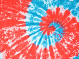 close up shot of red, white and light blue color tie dye fabric texture background