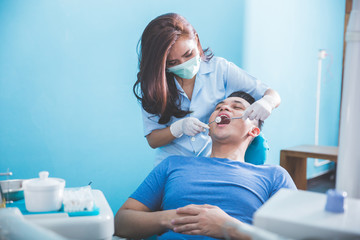 dentist talking to his patient at dental care clinic