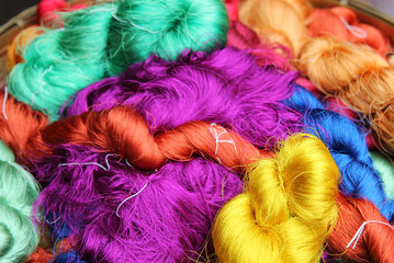 Travel to Bangkok, Thailand. Colorful threads of Thai silk closeup for background.
