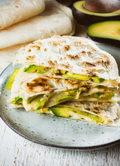 Mexican quesadilla. Tortilla with cheese and avocado