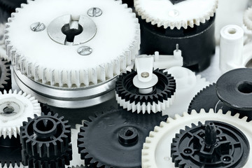 parts of industrial mechanisms. plastic black and white cogwheels.