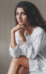 Portrait of woman sitting indoor