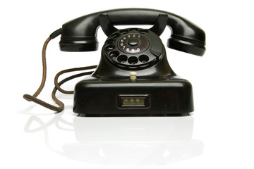 Vintage Phone, with the hook on..The telephone is really old, worn and dusty