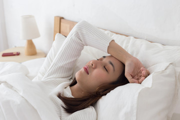 Woman have a headache after wake up in the morning