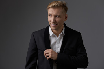 Handsome blond young man posing at studio