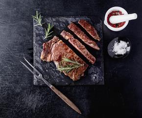 Steak on slate board with herbs