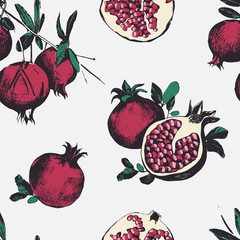 Seamless pattern with pomegranates. Fruits on white background.