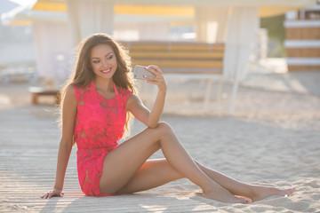 Beautiful girls selfie self photo on beach vacation during summer travel holidays. Posing for camera having fun.