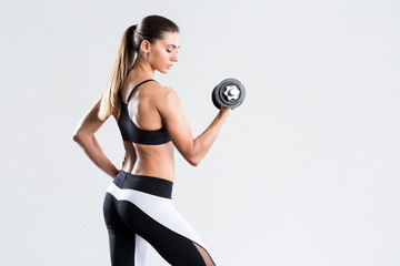 Woman with dumbbell fit slim abs body.
