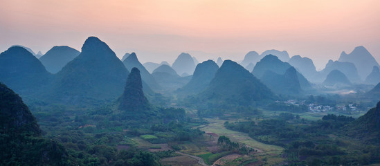 Foggy sunset. The view from the top of the Vine Mountains near Guilin - China (panorama)